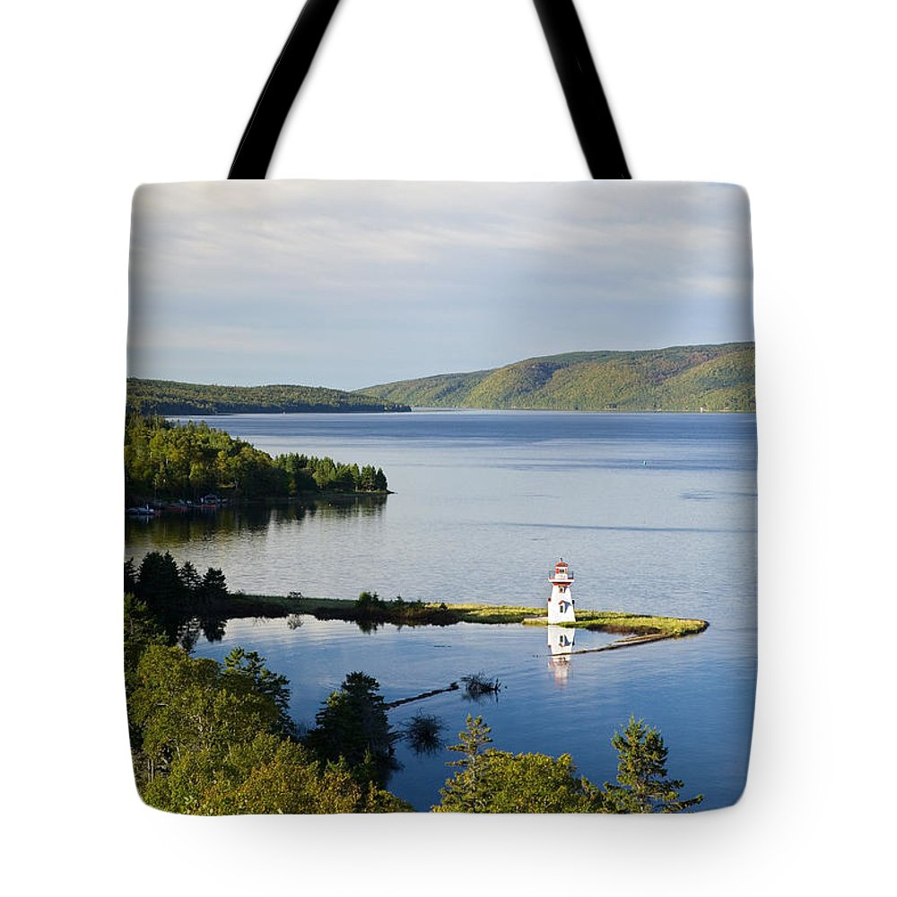 Bras Dor Lake Tote Bag featuring the photograph Lighthouse On Boulardarie Island by John Sylvester
