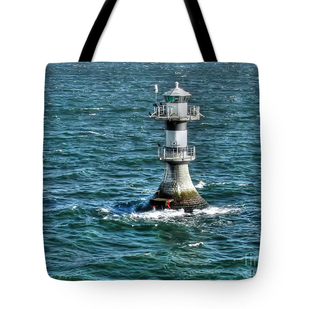 Lighthouse Tote Bag featuring the photograph Lighthouse On The Blue Sea by Mats Silvan