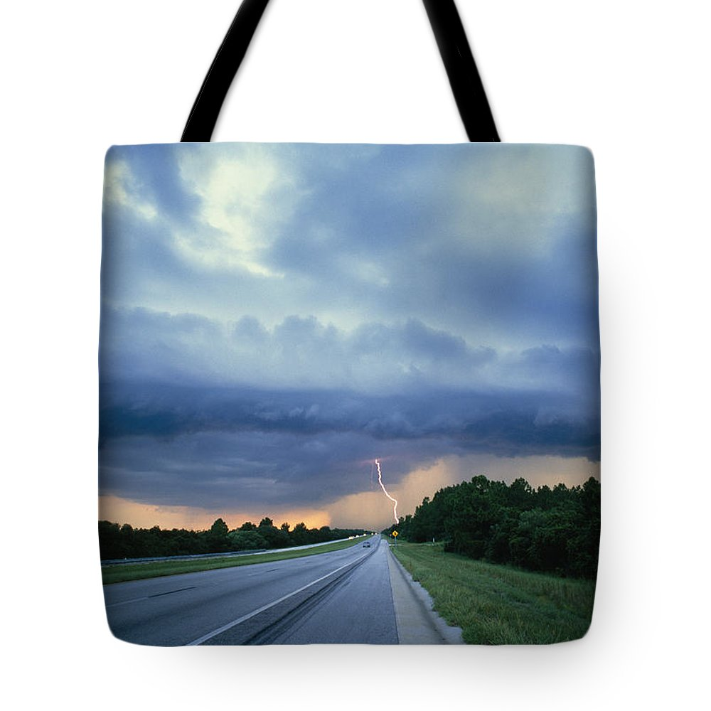 North America Tote Bag featuring the photograph Lightning Over Highway, Bee Line by Peter Krogh