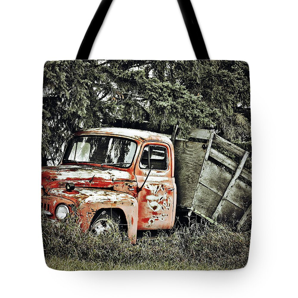 Photographer Tote Bag featuring the photograph Load Of Roots by The Artist Project