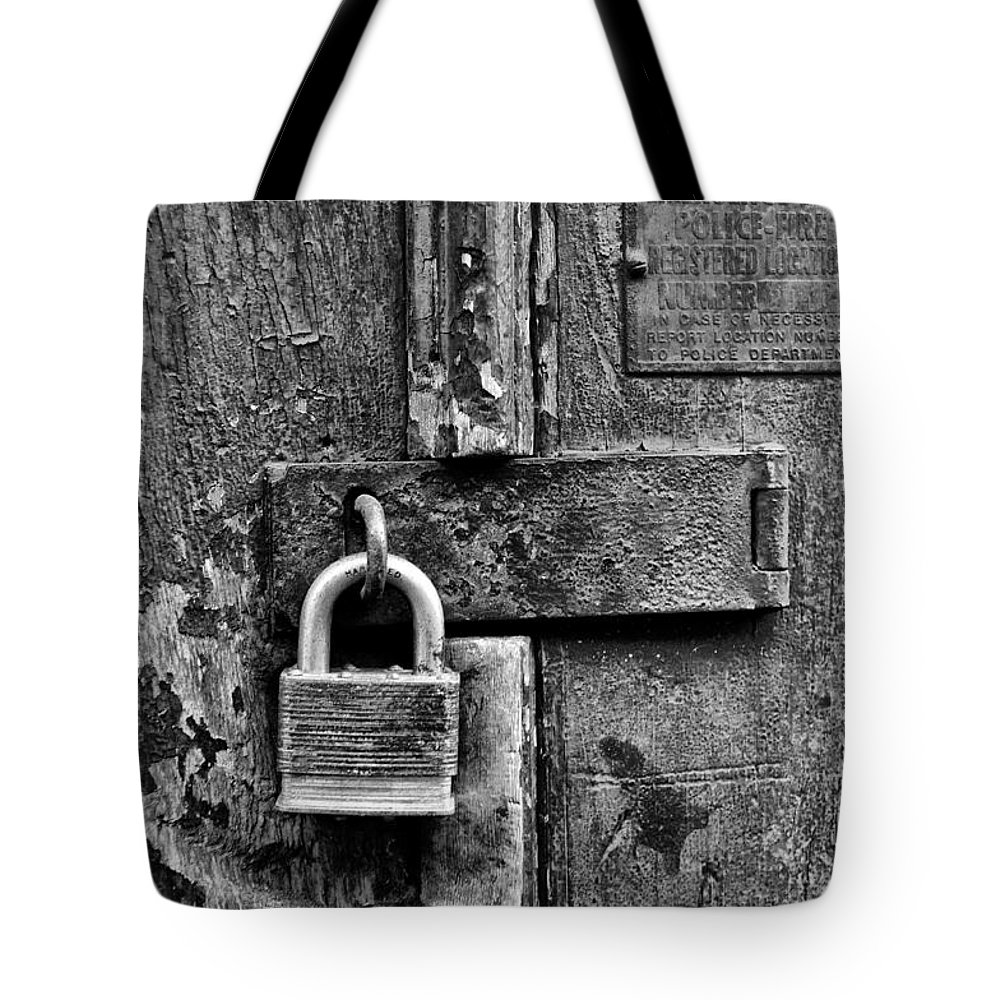 Locked Up Tote Bag featuring the photograph Locked Up by Bill Cannon