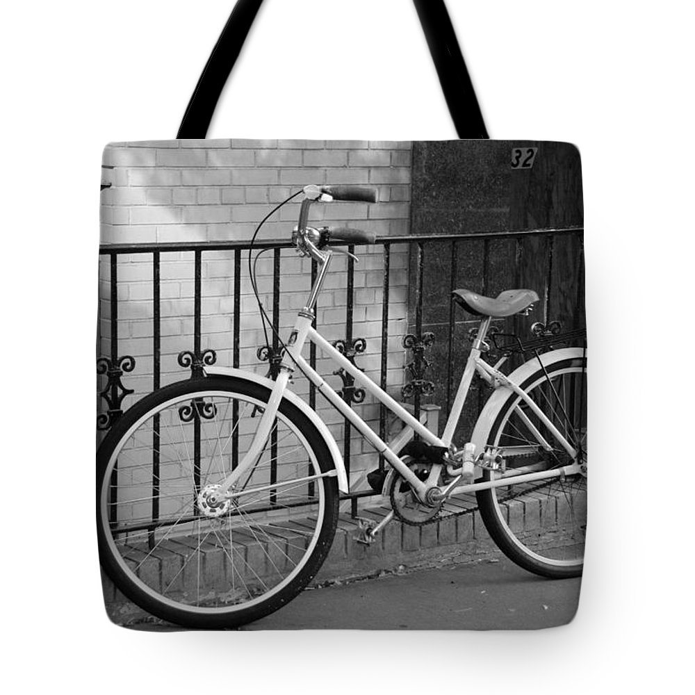 Black And White Tote Bag featuring the photograph Lonely Bike In Black And White by Rob Hans