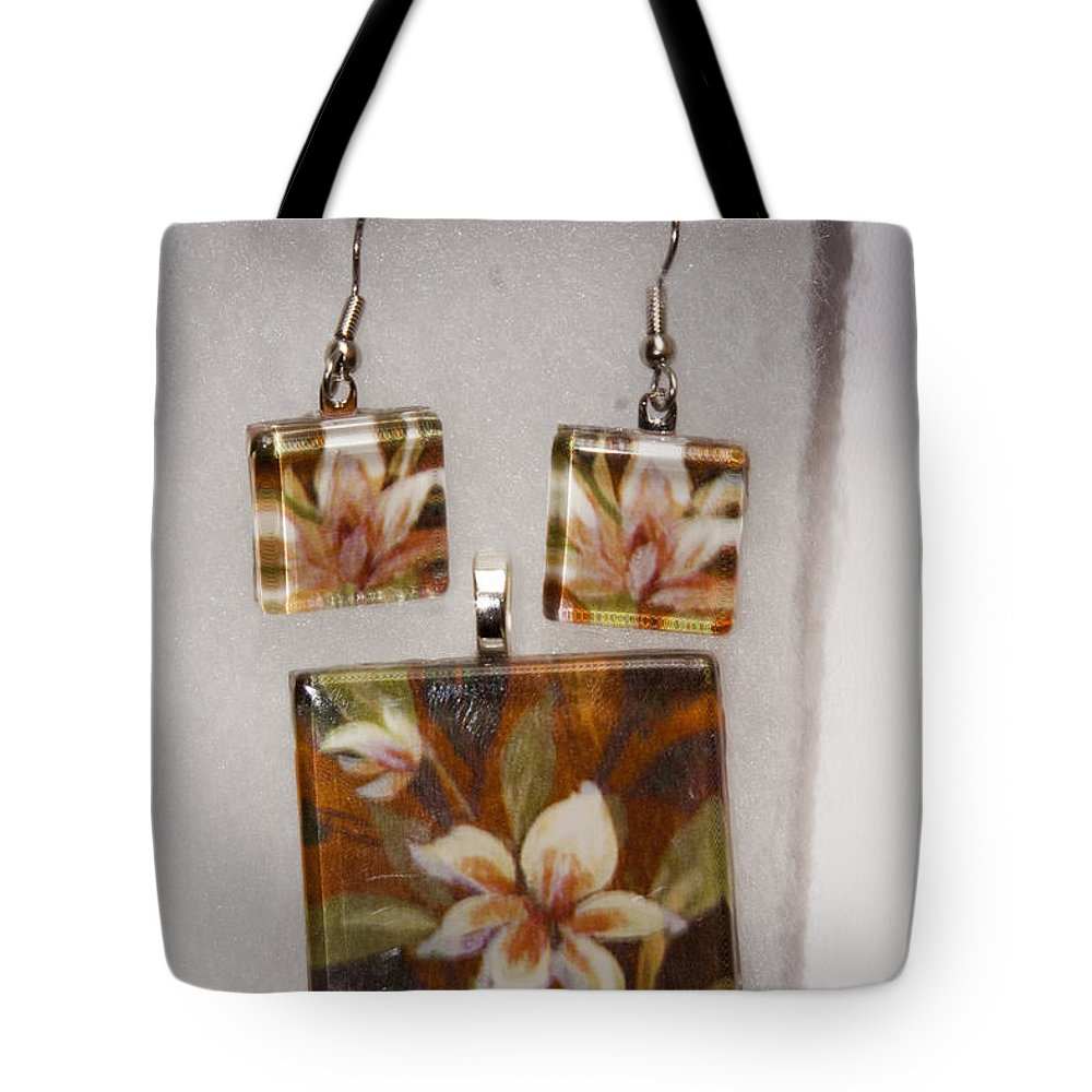 Flower Tote Bag featuring the jewelry Lotus Flower Pendant And Earring Set by Darleen Stry