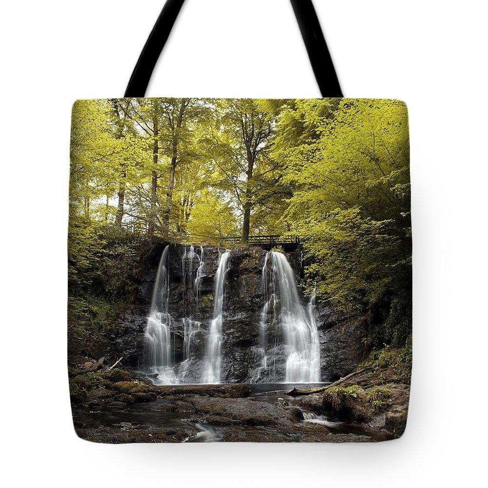 Co Antrim Tote Bag featuring the photograph Low Angle View Of A Waterfall In A by The Irish Image Collection