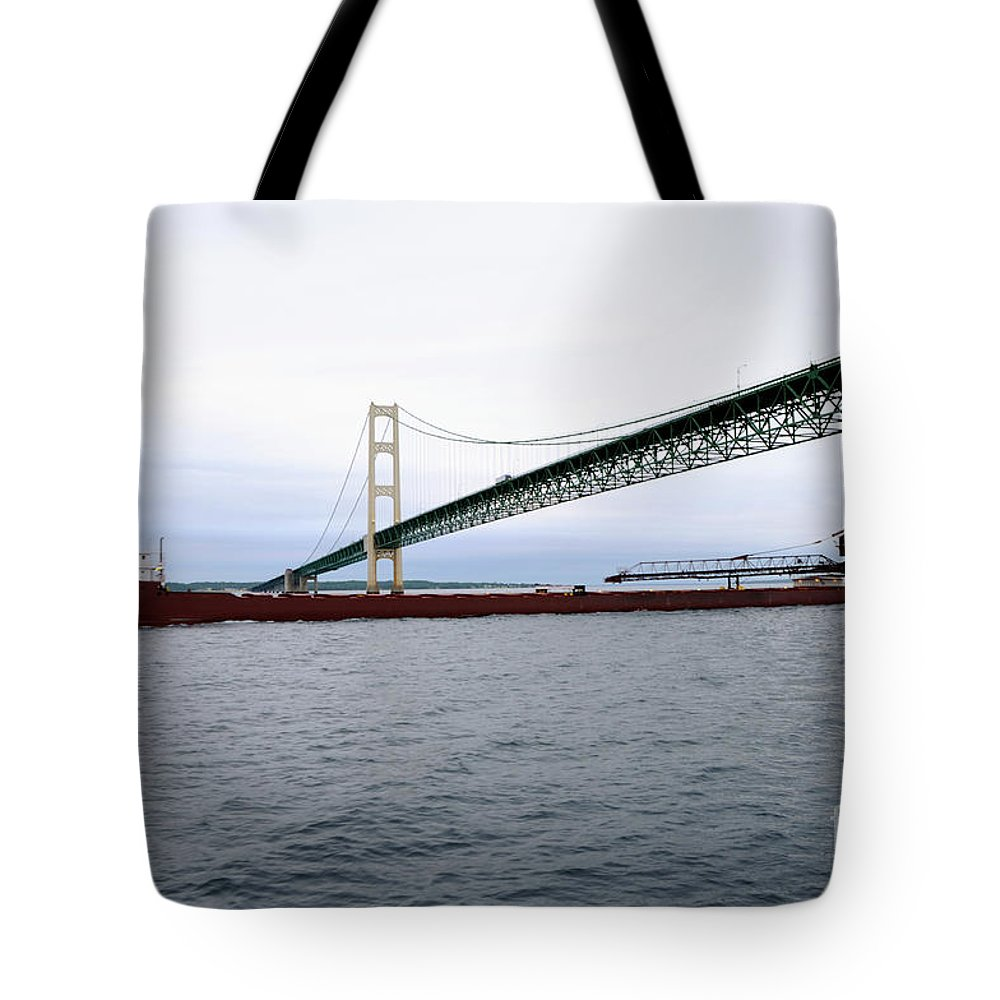Ship Tote Bag featuring the photograph Mackinac Bridge With Ship by Ronald Grogan
