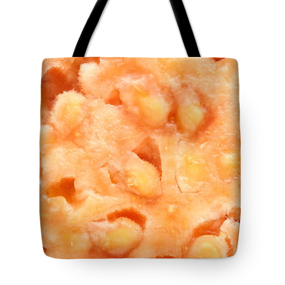 Guava Tote Bag featuring the photograph Macro Of Guava Fruit by Gaspar Avila