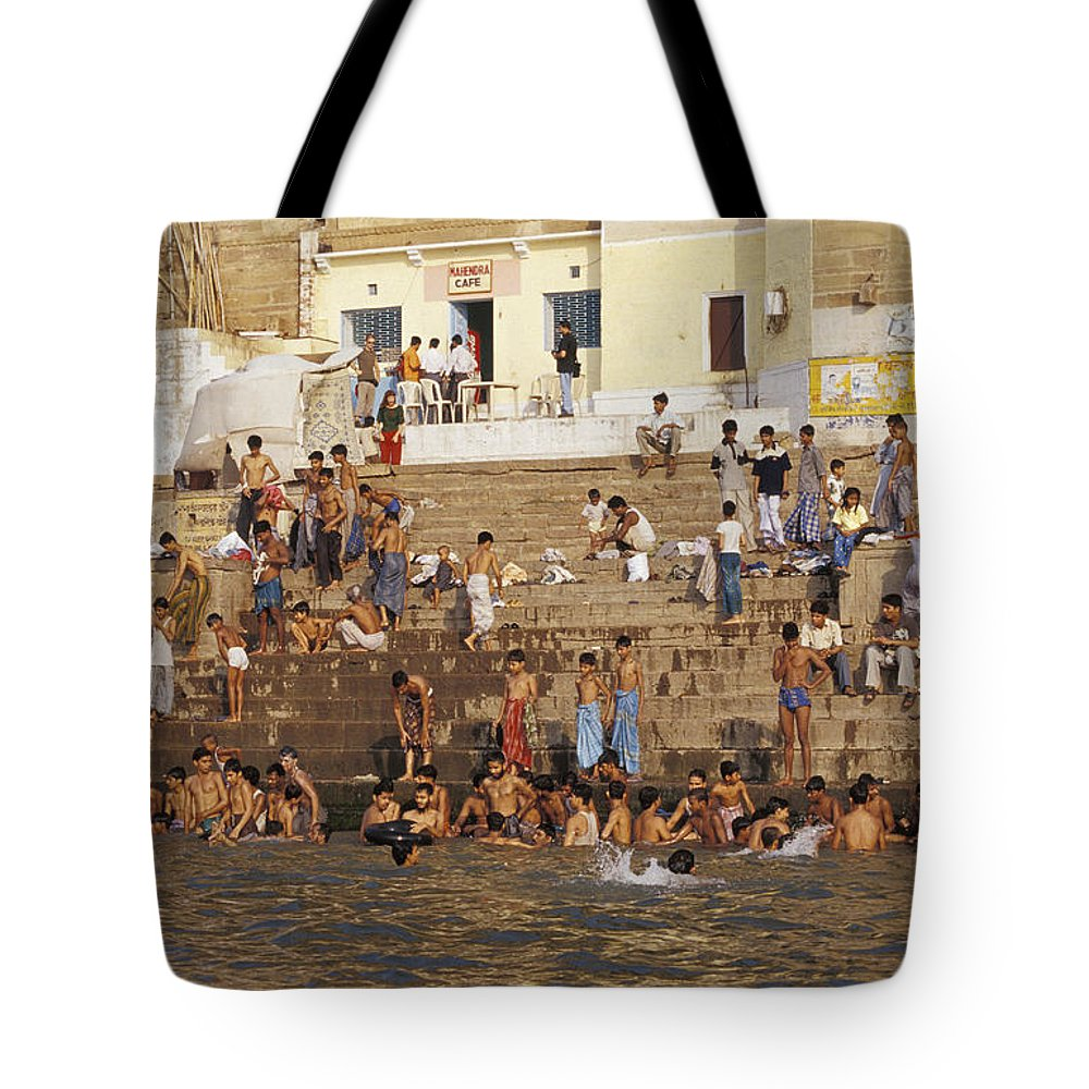 Varanasi Tote Bag featuring the photograph Men And Boys Bathe At An Ancient Ghat by Jason Edwards