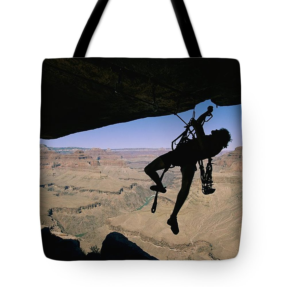 South Rim Tote Bag featuring the photograph Miles Kunkel Uses Aid To Climb An by Bill Hatcher