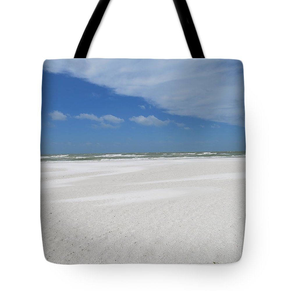 Sand Tote Bag featuring the photograph Miles Of Sand by Jean Macaluso