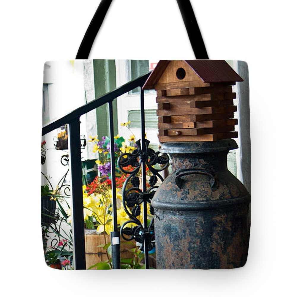 Milkcan Tote Bag featuring the photograph Milkcan And Birdhouse by Douglas Barnett