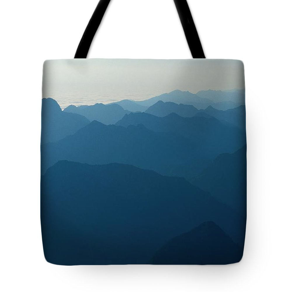 canada Tote Bag featuring the photograph Misty Mountain Ridges by Raymond Gehman