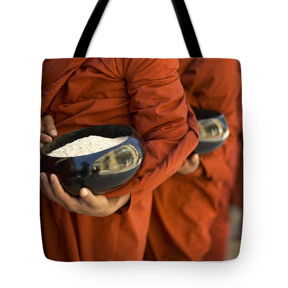 Adulthood Tote Bag featuring the photograph Monks With Rice Bowls, Inle Lake by Huy Lam