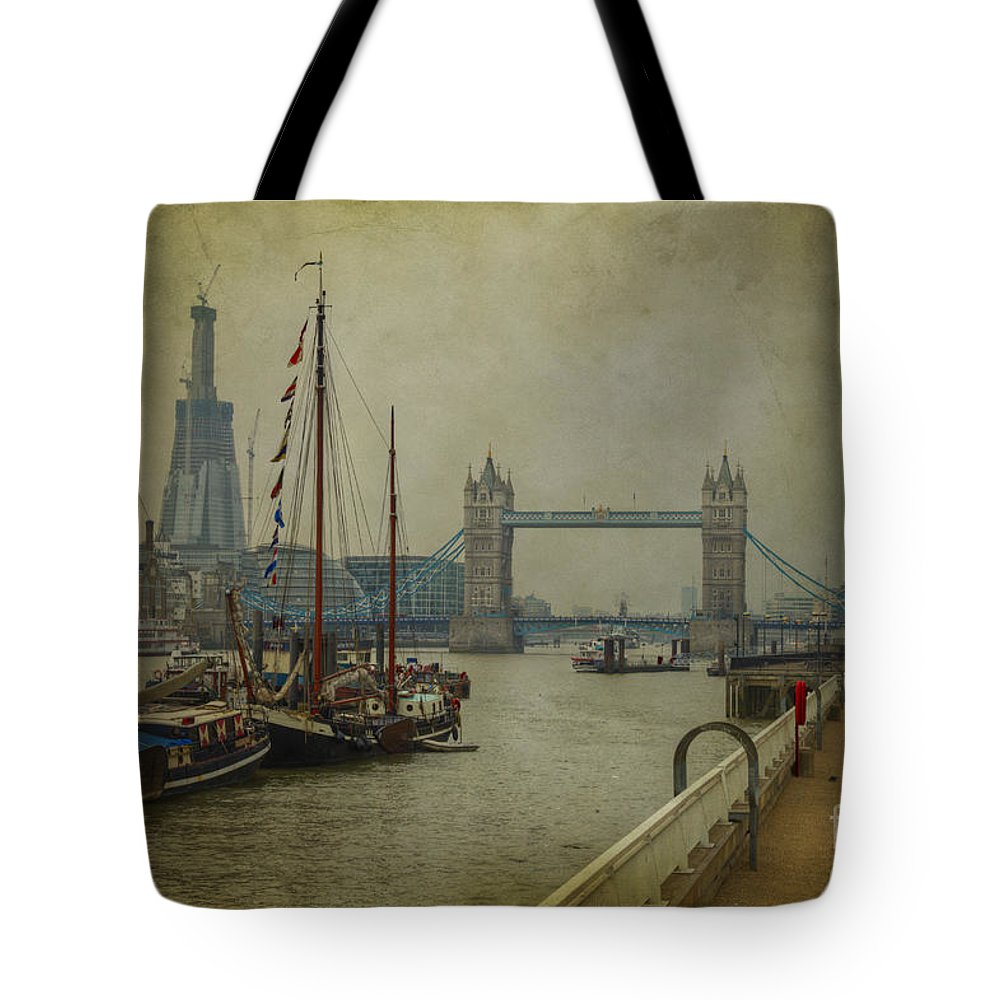 Thames Tote Bag featuring the photograph Moored Thames Barges. by Clare Bambers