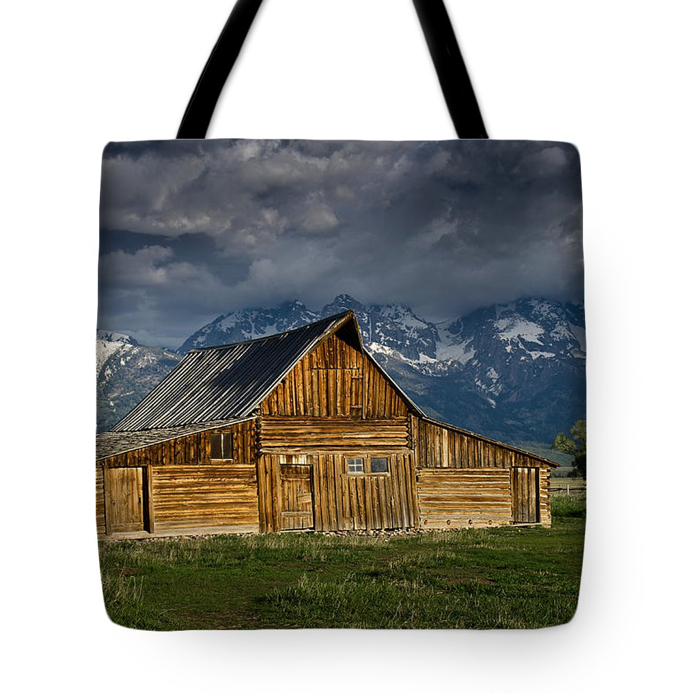 Grand Tetons Tote Bag featuring the photograph Mormon Barn Under Approaching Storm by Greg Nyquist