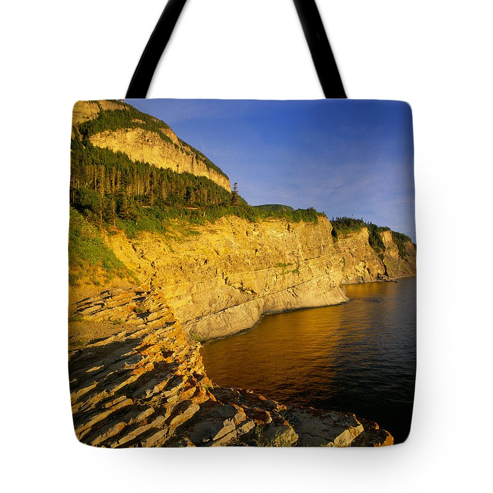 Cliffs Tote Bag featuring the photograph Mount St Alban Cliffs At Sunset by Yves Marcoux