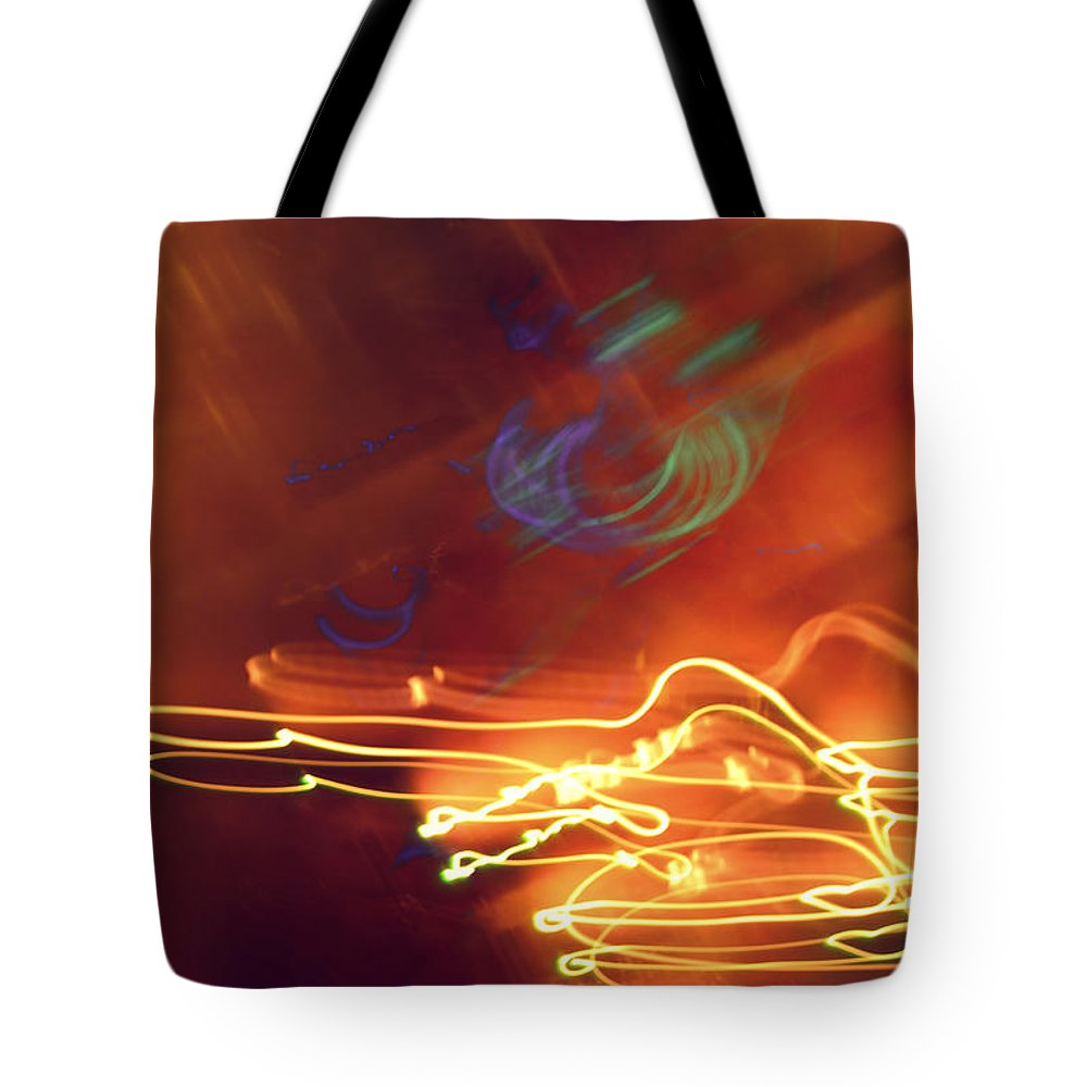Light Golden Amber Purple Brown Neon Abstract Tote Bag featuring the photograph neon IV by Diane montana Jansson