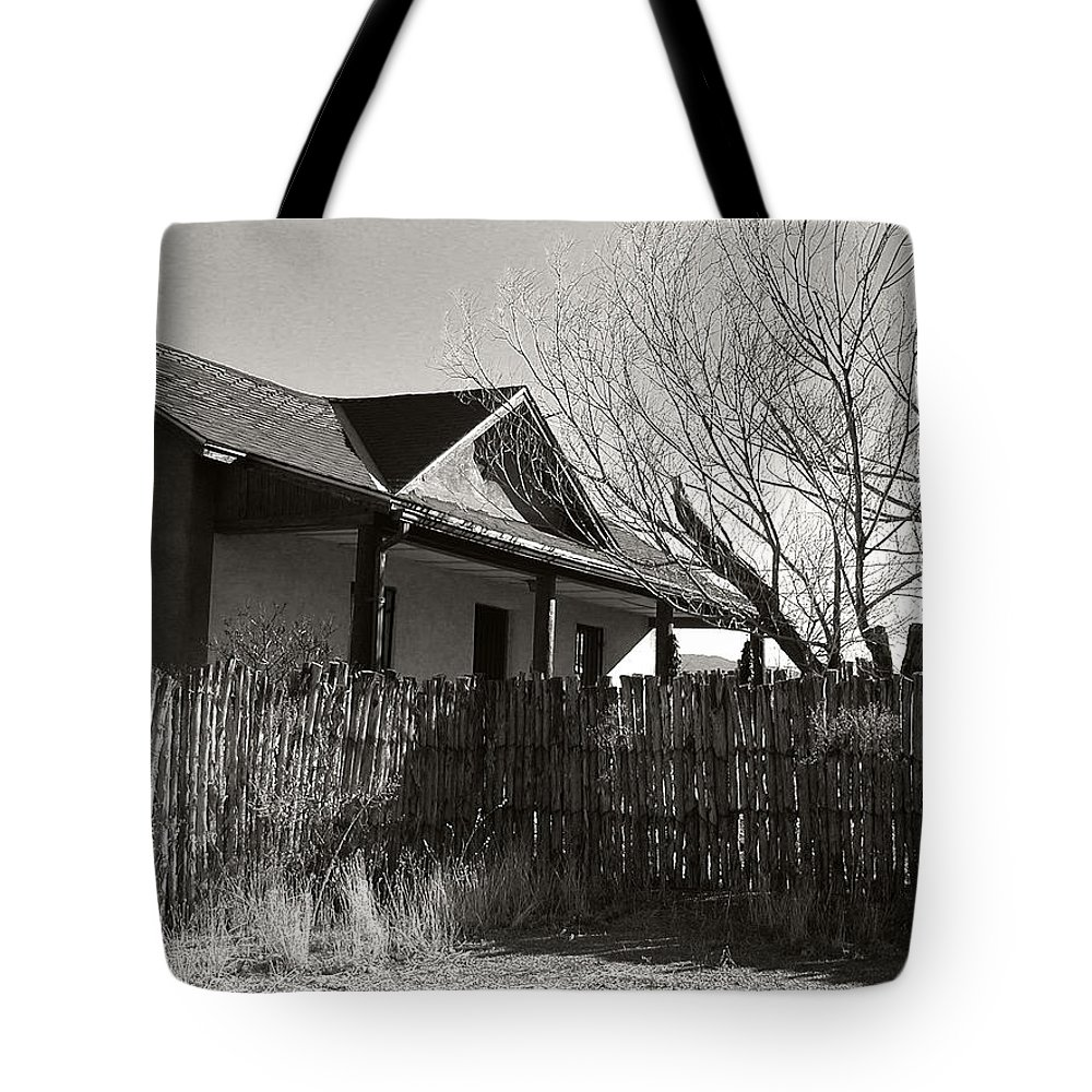 New Mexico Tote Bag featuring the photograph New Mexico Series - Fenced In House by Kathleen Grace