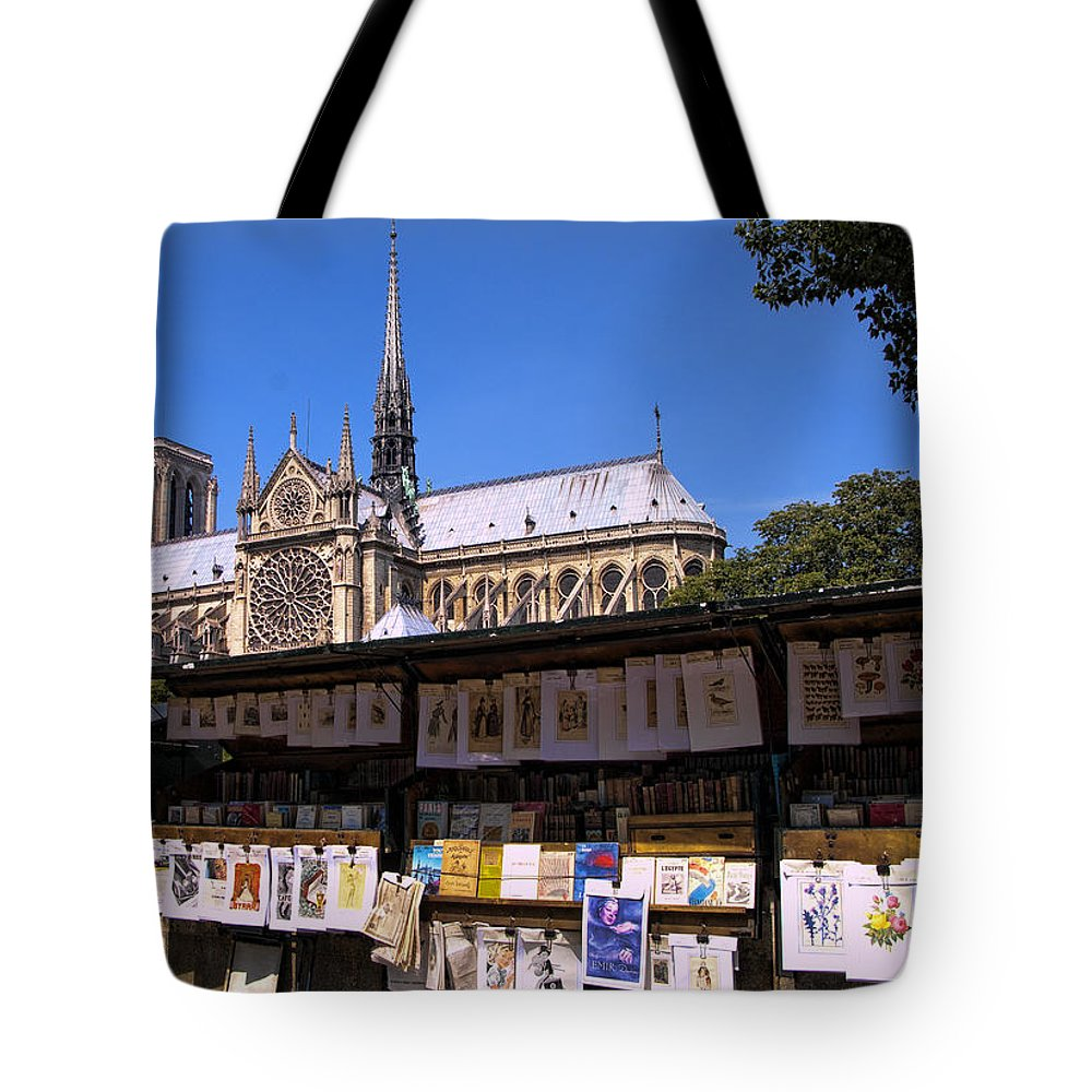Notre Dame Cathedral Tote Bag featuring the photograph Newstand Next To Notre Dame by Jon Berghoff