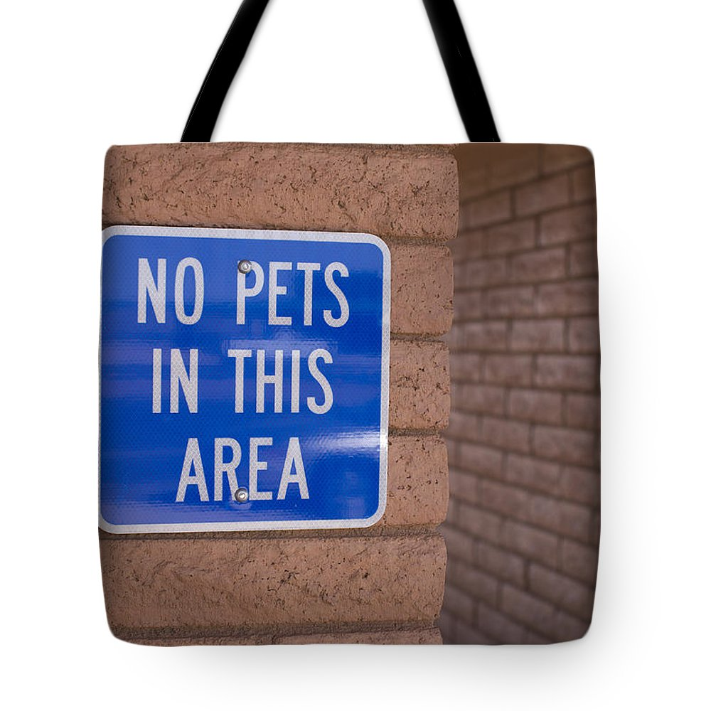 Outdoors Tote Bag featuring the photograph No Pet Sign At Rest Stop by John Burcham