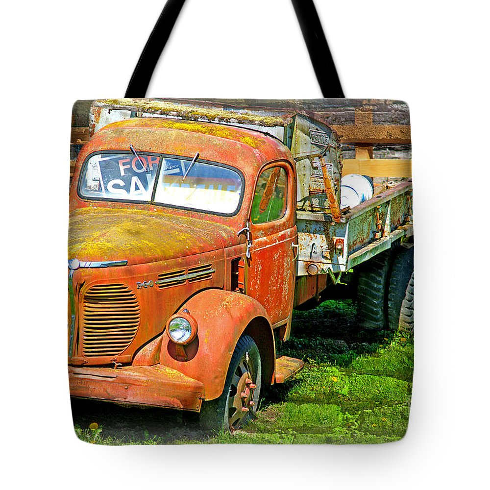 Old Trucks Tote Bag featuring the photograph Old Dumptruck On Brick Background-ca by Randy Harris