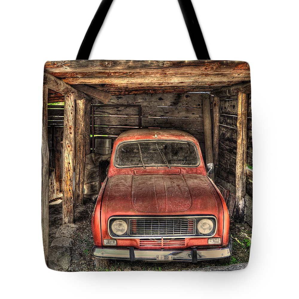 Car Tote Bag featuring the photograph Old Red Car In A Wood Garage by Mats Silvan
