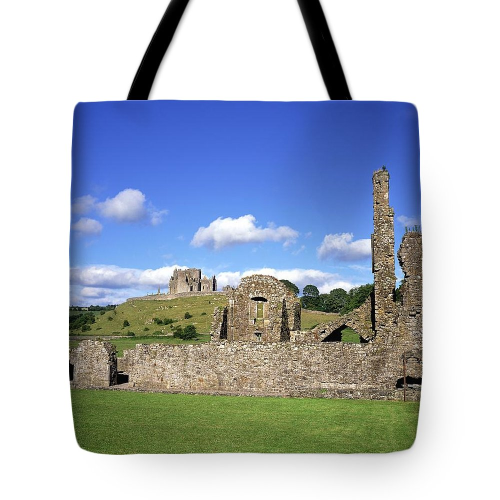 Architecture Tote Bag featuring the photograph Old Ruins Of An Abbey With A Castle In by The Irish Image Collection