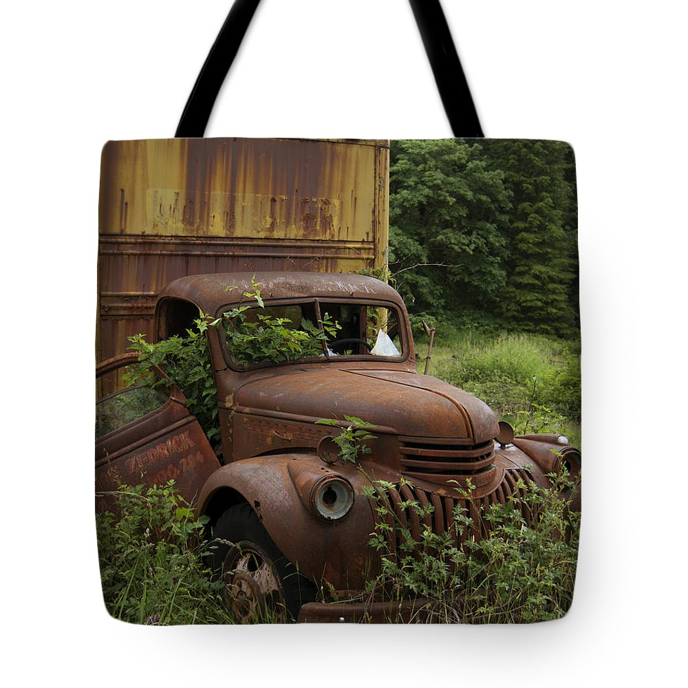 Old Truck In Rain Forest Tote Bag featuring the photograph Old Truck In Rain Forest by Gary Langley