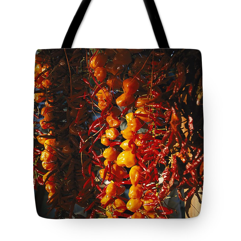 Plants Tote Bag featuring the photograph Organically-grown Peppers Are Hung by Stephen Alvarez
