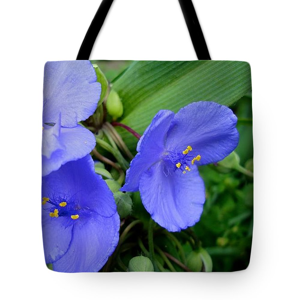 Blue Flower Tote Bag featuring the photograph Over The Fence by Joseph Yarbrough