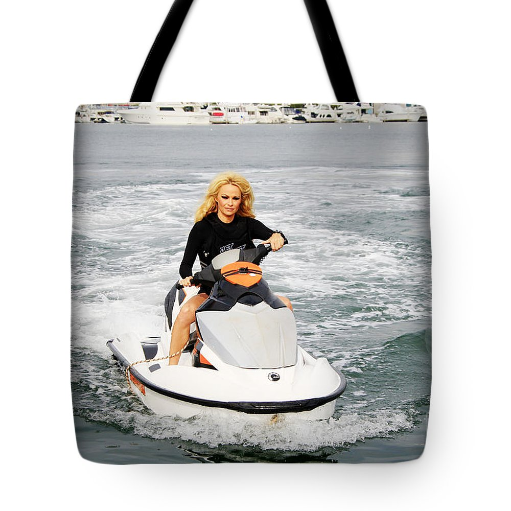 Pamela Anderson Tote Bag featuring the photograph Pamela Anderson Is A Jet Ski Vixen by Nina Prommer