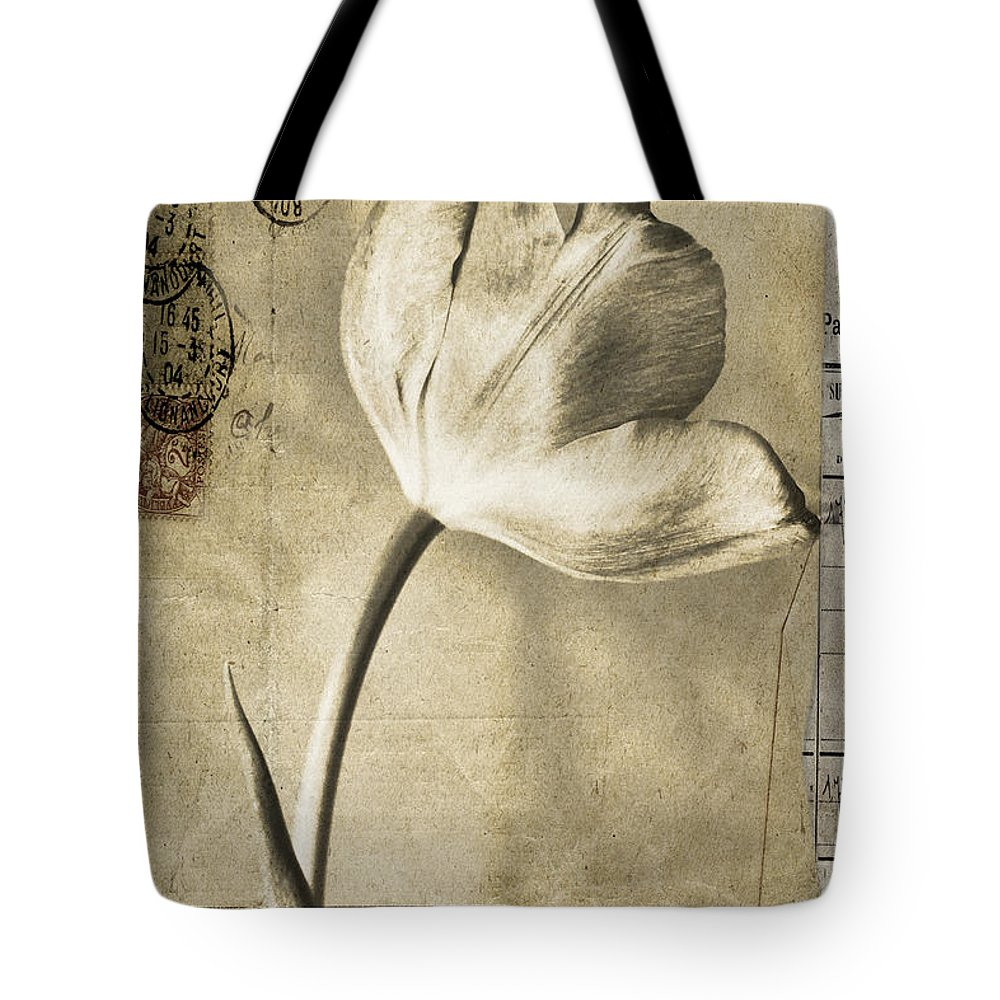 Florals Tote Bag featuring the photograph Paris Papers by Linda Dunn