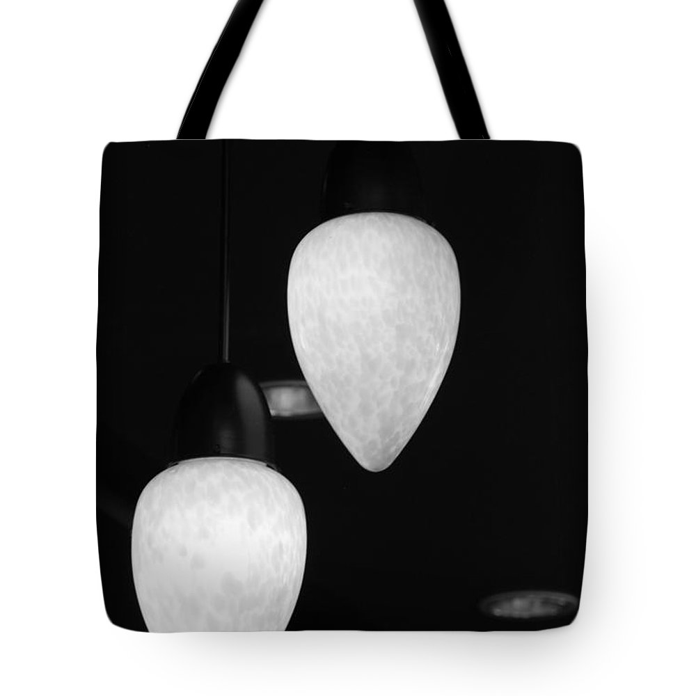 Lamps Tote Bag featuring the photograph Pendants In Black And White by Rob Hans