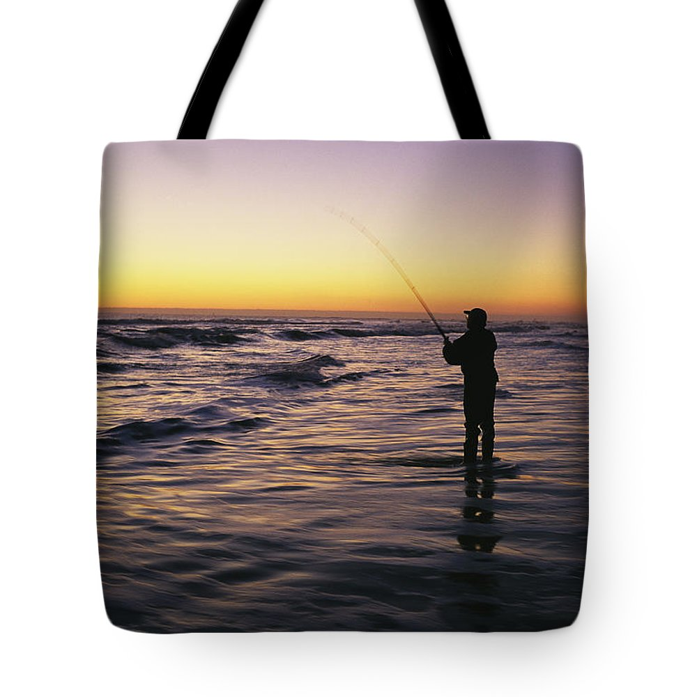 Fishing And Fishermen Tote Bag featuring the photograph People Are Surf Fishing For Red Drum by Stephen Alvarez
