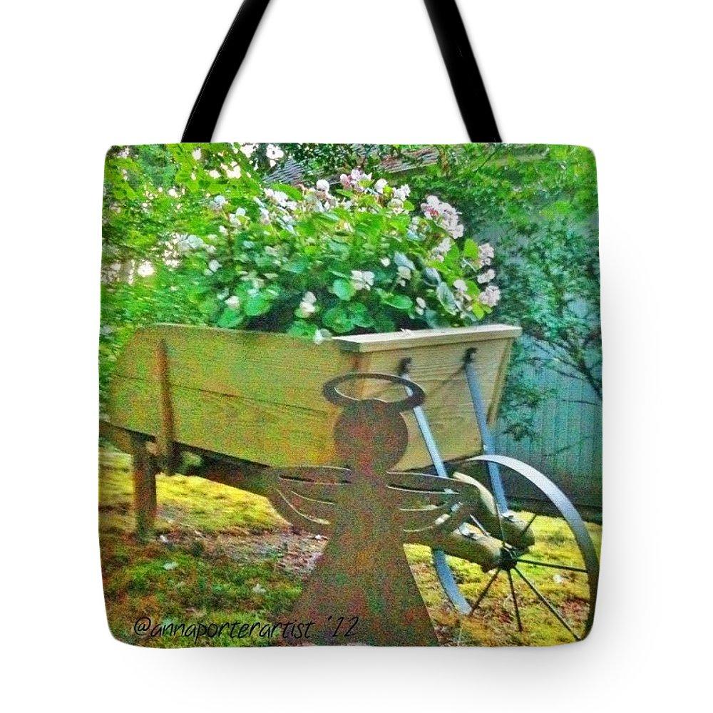 Wheelbarrow Tote Bag featuring the photograph Funky Wheelbarrow Full Of Flowers by Anna Porter