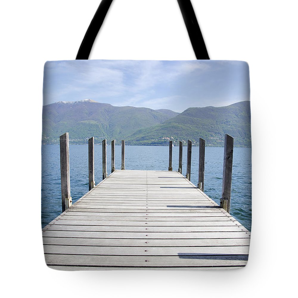 Pier Tote Bag featuring the photograph Pier And Snow-capped Mountain by Mats Silvan