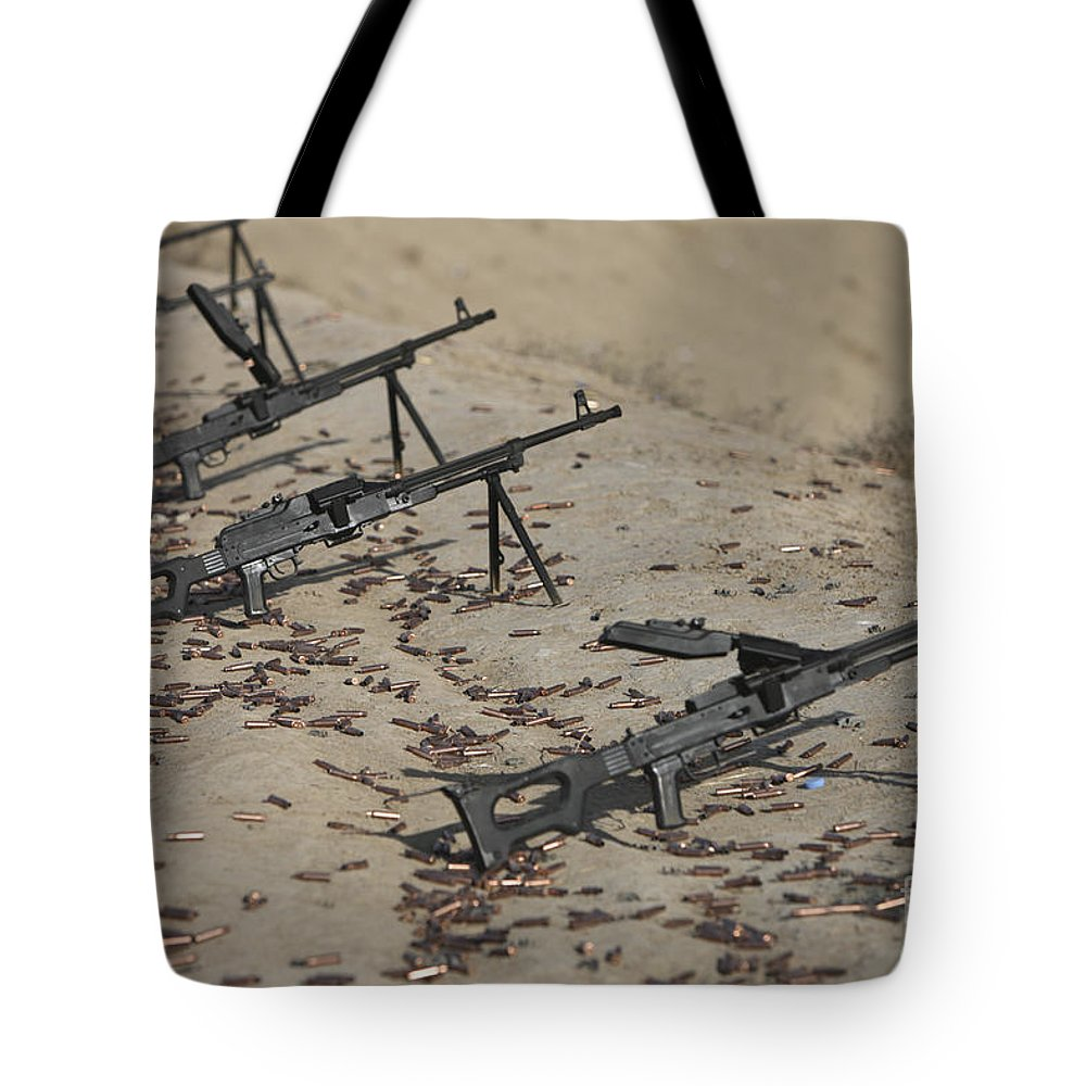 Kunduz Tote Bag featuring the photograph Pk Machine Guns And Spent Cartridges by Terry Moore