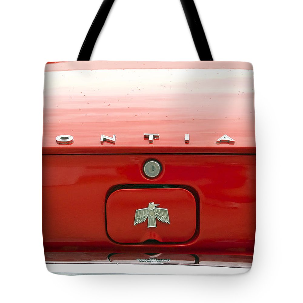 Transportation Tote Bag featuring the photograph Pontiac Firebird Emblem by Thomas Woolworth