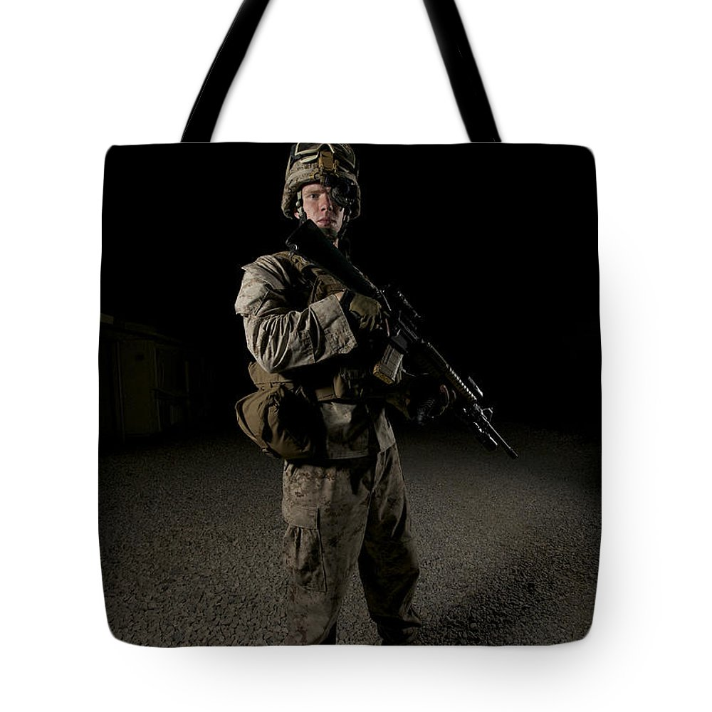 Operation Enduring Freedom Tote Bag featuring the photograph Portrait Of A U.s. Marine by Terry Moore