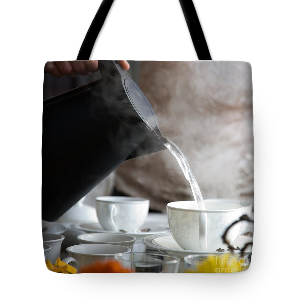 Tea Tote Bag featuring the photograph Pouring Hot Water by Kati Finell