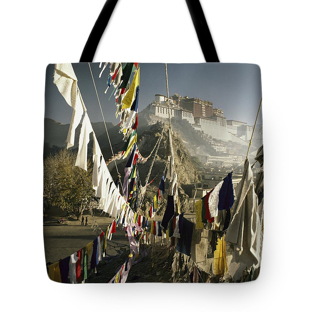 Asia Tote Bag featuring the photograph Prayer Flags Hang In The Breeze by Gordon Wiltsie