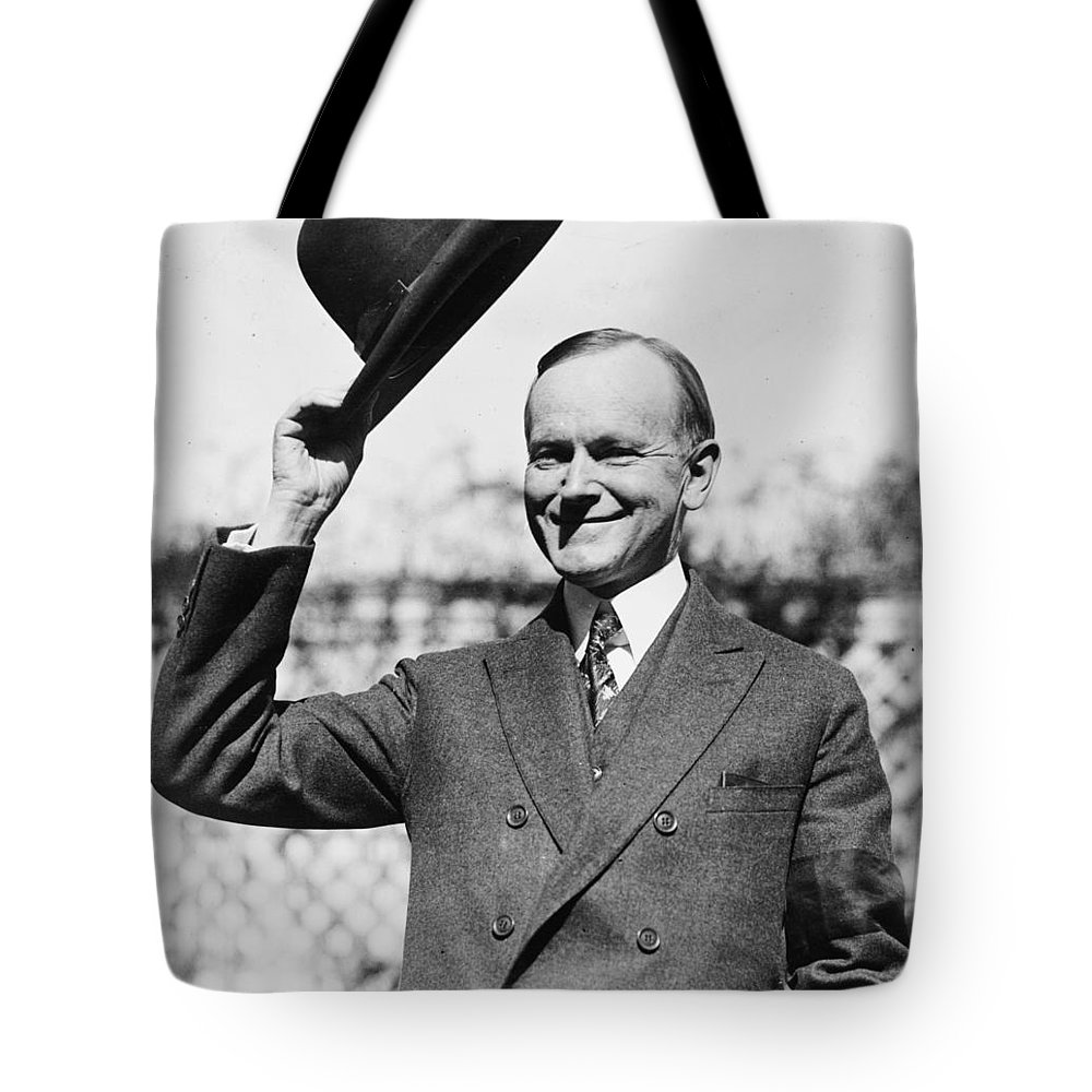 president Calvin Coolidge Tote Bag featuring the photograph President Calvin Coolidge Tips Is Hat by International Images