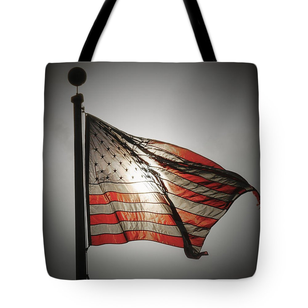 American Flag Tote Bag featuring the photograph Proud by Chris Brannen