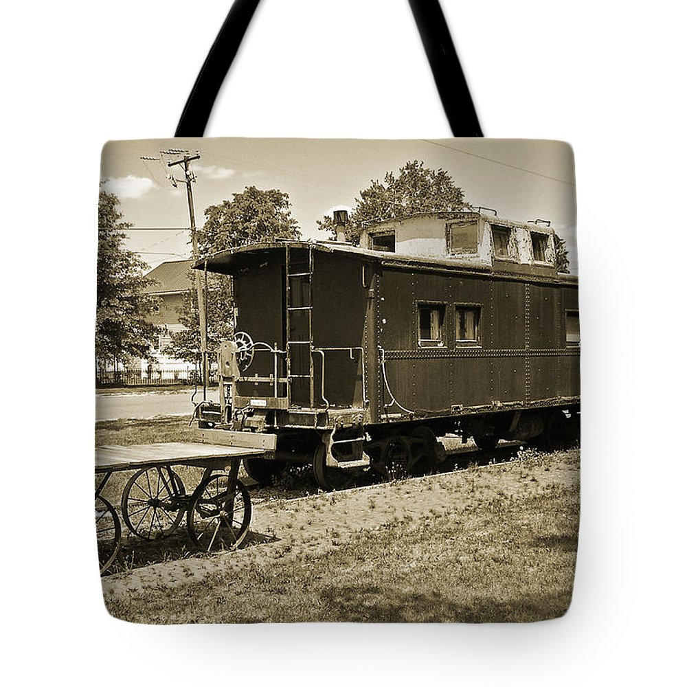 2d Tote Bag featuring the photograph Railroad Car And Wagon by Brian Wallace