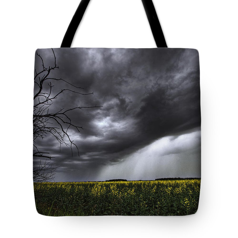 Alberta Tote Bag featuring the photograph Rain And Thunderstorm Over A Canola by Dan Jurak