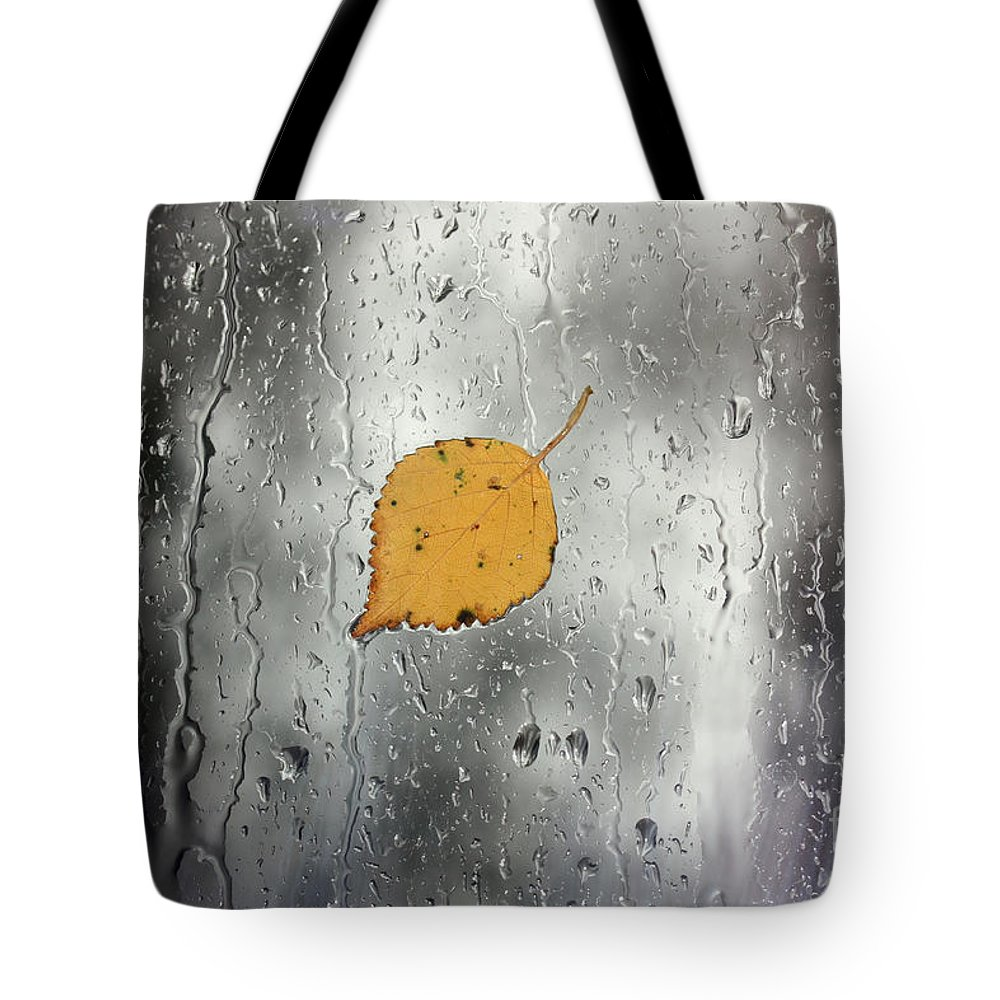Leaf Tote Bag featuring the photograph Rain On Window With Leaf by Simon Bratt Photography LRPS