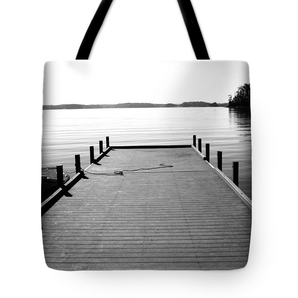 Boat Dock Tote Bag featuring the photograph Reaching Out by Lisha Segur