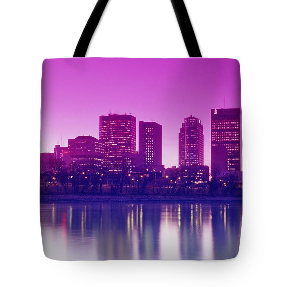 City Tote Bag featuring the photograph Red River And Downtown Winnipeg by Dave Reede