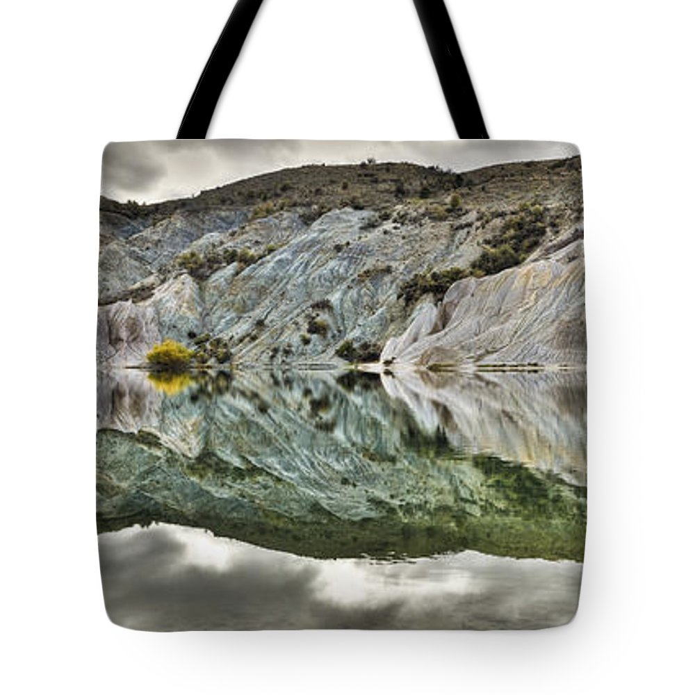 Hhh Tote Bag featuring the photograph Reflection On Blue Lake, St Bathans by Colin Monteath
