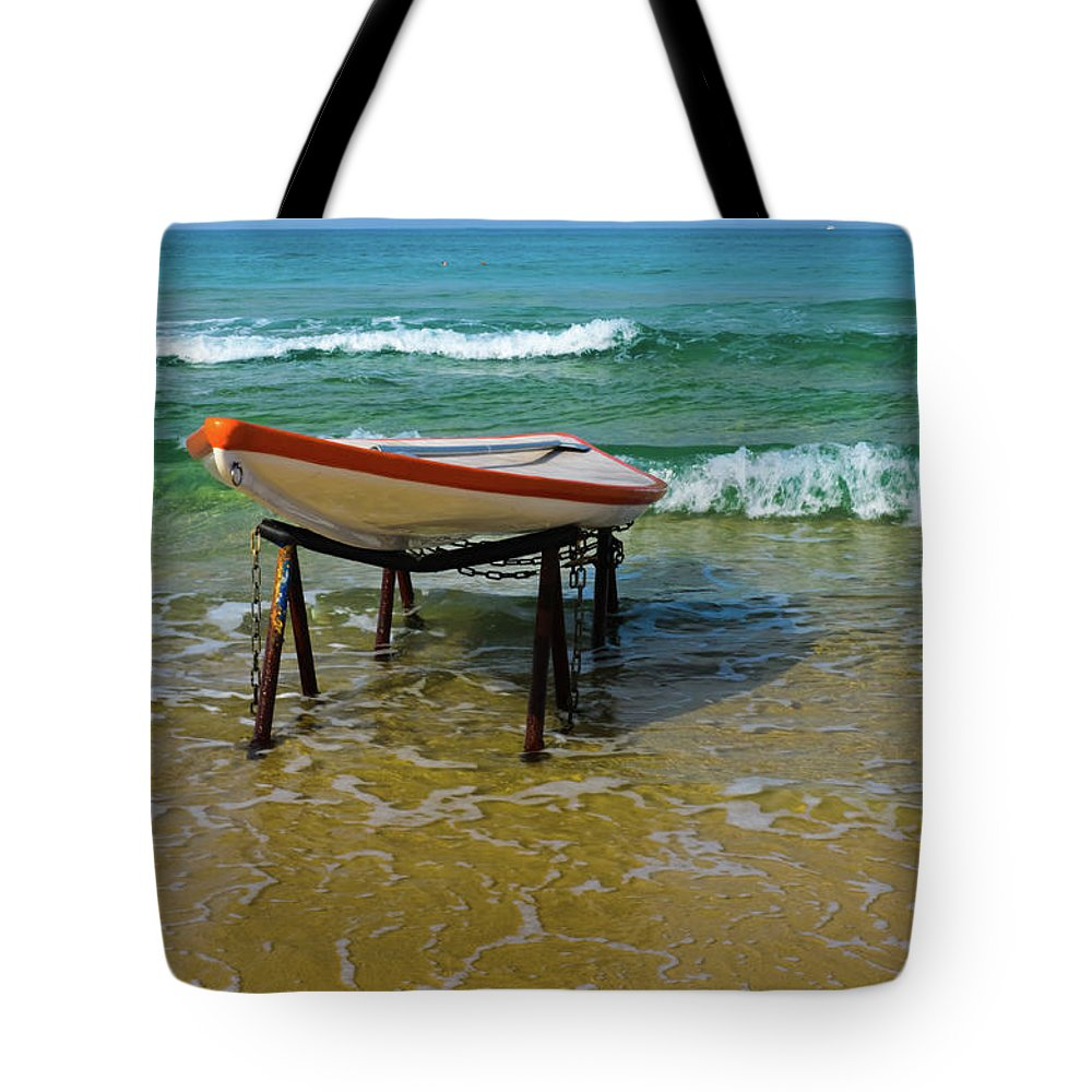 Boat Tote Bag featuring the photograph Rescue Boat In Anticipation Of Work by Michael Goyberg