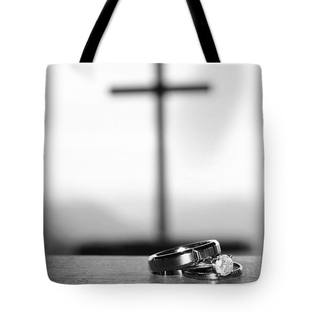 Engagement Tote Bag featuring the photograph Rings And Cross by Kelly Hazel
